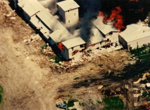 The Branch Davidian Mount Carmel Center engulfed in flames on April 19, 1993. (Photo via Wikimedia Commons)